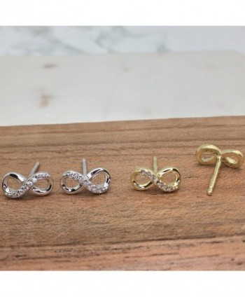 4d037f8fb Available. Sterling Silver Cubic Zirconia Half Set Infinity Stud Earrings -  CN11UZ1P303; Rhodium Sterling ...