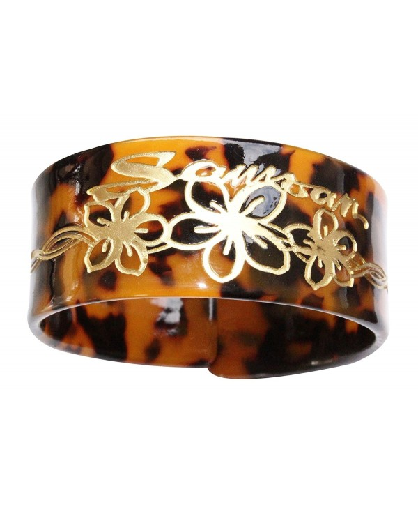 Tortoise style bangle with carved design. - CH185R58H6U
