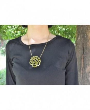 HUAN XUN Gold Stainless Monogram in Women's Pendants